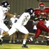 Carl Albert\'s Trevante Porter (3) makes a catch as Shawnee\'s Brett Davis (9) and Beau Davis (8) chase him down during the high school football game between Carl Albert and Shawnee, Friday, Oct. 3, 2008, at Carl Albert High School in Midwest City, Okla. BY SARAH PHIPPS, THE OKLAHOMAN
