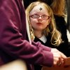 Maddisun Wagoner, 5, looks up to her grandmother on Wednesday, Feb. 22, 2012 during mass at St. Pius Catholic Church in Coeur d\'Alene, Idaho. Ash Wednesday marks the beginning of the Lent season which lasts 40 days. (AP Photo/Coeur d\'Alene Press, Shawn Gust)