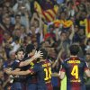 FC Barcelona\'s Lionel Messi from Argentina, left, celebrates his goal with team mates during a Spanish La Liga soccer match against Real Madrid at the Camp Nou stadium in Barcelona, Spain, Sunday, Oct. 7, 2012. (AP Photo/Andres Kudacki)