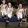 Photo - GIRLS HIGH SCHOOL BASKETBALL / CELEBRATION: Okarche's Kristen Meyer, left, Brooke Edwards, and Macy Kunneman celebrate as Seiling's Aubrey Colvard walks off the court during the Class A girls basketball state tournament at the State Fair Arena in Oklahoma City, Friday, March 5, 2010.  Photo by Bryan Terry, The Oklahoman ORG XMIT: KOD