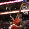 Photo - Milwaukee Bucks' Brandon Knight (11) dunks the ball past Philadelphia 76ers' Thaddeus Young, left, during the first half of an NBA basketball game, Monday, Feb. 24, 2014, in Philadelphia. (AP Photo/Chris Szagola)