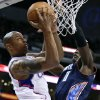 Los Angeles Clippers forward Caron Butler, left, shoots against Charlotte Bobcats forward Bismack Biyombo during the first half of an NBA basketball game in Los Angeles, Tuesday, Feb. 26, 2013. (AP Photo/Chris Carlson)