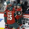 Photo - Minnesota Wild right wing Cal Clutterbuck (22), center, celebrates with teammates Devin Setoguchi, left,  Jared Spurgeon (46), and Jonas Brodin (25) after Clutterbuck scored on Los Angeles Kings goalie Jonathan Bernier during the first period of an NHL hockey game in St. Paul, Minn., Tuesday, April 23, 2013. (AP Photo/Ann Heisenfelt)