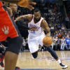 Oklahoma City\'s James Harden dribbles past Toronto\'s Sonny Weems during their NBA basketball game at the OKC Arena in downtown Oklahoma City on Sunday, March 20, 2011. Photo by John Clanton, The Oklahoman