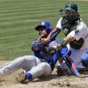 Chicago Cubs\' Starlin Castro, left, is tagged out at the plate by Oakland Athletics catcher Derek Norris while trying to score from second base on a single by Alfonso Soriano during the fourth inning of a baseball game on Thursday, July 4, 2013, in Oakland, Calif. (AP Photo/Marcio Jose Sanchez)