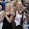 Newlywed Thunder fans from Australia, Magda Bartucciotto, left, and Andrew Bartucciotto, cheer during player introductions before the NBA basketball game between the Minnesota Timberwolves and the Oklahoma City Thunder at the Oklahoma City Arena, Monday, November 22, 2010, in Oklahoma City. The couple scheduled a trip to Oklahoma City to see the Thunder play as part of their honeymoon in the United States.. Photo by Nate Billings, The Oklahoman