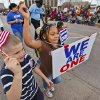 Micheal Mills, 7, and Ayanna Morales, 7, march Monday in the streets during Martin Luther King Jr. Day parade through downtown Oklahoma City. Photos by Chris Landsberger, The Oklahoman