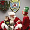 Santa stopped by the Edmond police station Saturday, Dec. 22, 2012, to visit with children, hear their Christmas lists and pose for keepsake photos that were provided for the children by Edmond police department. Sitting on his lap is Jackson Rocamontes, 3, and his baby sister, Arya, 7 weeks old. Helping with the photos is one of two elves who were on hand. Playing Santa is Boyd Mize, a retired detective with the Edmond police department. This is the eighth year Mize has donned the Santa suit for the police department\'s day with Santa. But Mize said this is the first year he didn\'t have to wear a fake beard; all the hair on Santa\'s face is natural this year. Photo by Jim Beckel, The Oklahoman