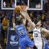 Photo - Oklahoma City Thunder forward Kevin Durant (35) shoots against Memphis Grizzlies center Marc Gasol (33) in the first half of Game 6 of an opening-round NBA basketball playoff series Thursday, May 1, 2014, in Memphis, Tenn. (AP Photo/Mark Humphrey)