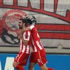 Olympiakos\' Giannis Maniatis celebrates with teammate Kostas Manolas after scoring against Arsenal during a group B Champions League soccer match in the port of Piraeus, near Athens, Tuesday, Dec. 4, 2012. (AP Photo/Thanassis Stavrakis)