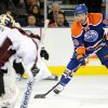 Edmonton Oilers\' Sam Gagner scores on Colorado Avalanche goalie Semyon Varlamov during the first period of an NHL hockey game in Edmonton, Alberta, on Friday, Dec. 9, 2011. (AP Photo/The Canadian Press, John Ulan)