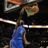Photo - Oklahoma City guard/forward Kevin Durant dunks the ball against the San Antonio Spurs during the first half of an NBA basketball game at the AT&T Center in San Antonio, Saturday, Nov. 14, 2009. (AP Photo/ Bahram Mark Sobhani) ORG XMIT: TXMS105