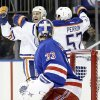Photo - Edmonton Oilers' Ryan Smyth (94) celebrates with teammate David Perron (57) as New York Rangers goalie Cam Talbot (33) watches after Smyth scored during the first period of an NHL hockey game on Thursday, Feb. 6, 2014, in New York. (AP Photo/Frank Franklin II)