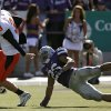 Oklahoma State\'s Brandon Weeden (3) runs with the ball past Kansas State\'s Jarell Childs (26) during the second half of the college football game between the Oklahoma State University Cowboys (OSU) and the Kansas State University Wildcats (KSU) on Saturday, Oct. 30, 2010, in Manhattan, Kan. Photo by Chris Landsberger, The Oklahoman