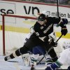 Photo - Anaheim Ducks' Corey Perry controls the puck in front of Vancouver Canucks goalie Eddie Lack, of Sweden, during the first period of an NHL hockey game on Wednesday, Jan. 15, 2014, in Anaheim, Calif. (AP Photo/Jae C. Hong)