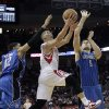 Photo - Houston Rockets guard Jeremy Lin (7) drives to the basket between Orlando Magic forward Tobias Harris (12) and center Nikola Vucevic (9) during the second half of an NBA basketball game Monday, April 1, 2013 in Houston. Houston won 110-103. (AP Photo/Bob Levey)