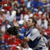 Photo - Los Angeles Dodgers catcher A.J. Ellis catches a pop out by Philadelphia Phillies' Jimmy Rollins during the first inning of a baseball game, Saturday, May 24, 2014, in Philadelphia. (AP Photo/Matt Slocum)