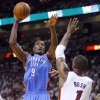 Oklahoma City\'s Serge Ibaka (9) shoots over Miami\'s Chris Bosh (1) during Game 4 of the NBA Finals between the Oklahoma City Thunder and the Miami Heat at American Airlines Arena, Tuesday, June 19, 2012. Photo by Bryan Terry, The Oklahoman