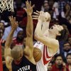 Houston Rockets\' Omer Asik, right, loses the ball under pressure from Miami Heat\'s Shane Battier (31) in the first half of an NBA basketball game, Monday, Nov. 12, 2012, in Houston. (AP Photo/Pat Sullivan)