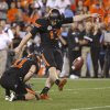 Oklahoma State\'s Quinn Sharp (13) kicks the game-winning field goal during the Fiesta Bowl between the Oklahoma State University Cowboys (OSU) and the Stanford Cardinal at the University of Phoenix Stadium in Glendale, Ariz., Tuesday, Jan. 3, 2012. Photo by Bryan Terry, The Oklahoman
