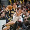 Photo -   Indiana Pacers' Tyler Hansbrough drives sd Chicago Bulls' Luol Deng defends during the first quarter of an NBA basketball game in Chicago on Monday, March 5, 2012. (AP Photo/Charles Cherney)