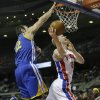 Photo - Detroit Pistons forward Kyle Singler (25) shoots while defended by Golden State Warriors center Andrew Bogut (12) during the first half of an NBA basketball game in Auburn Hills, Mich., Monday, Feb. 24, 2014. (AP Photo/Carlos Osorio)