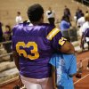 NWC\'s Darius Bias leaves the field with his arm around a young man at the Northwest Classen vs. Western Heights high school football game at Taft Stadium Thursday, September 20, 2012. Photo by Doug Hoke, The Oklahoman