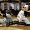 UC Irvine\'s Kris Paulino (24) slides home to score past OSU\'s Bryan Case (34) in the 4th inning during Game 1 of the NCAA baseball Stillwater Super Regional between Oklahoma State and UC Irvine at Allie P. Reynolds Stadium in Stillwater, Okla., Friday, June 6, 2014. Photo by Nate Billings, The Oklahoman