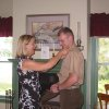This May 2004 photo provided by Lisa Freeman shows her pinning on her son Matthew\'s 1st Lt. rank after his father swore him at their home in Richmond Hill, Ga. Marine Capt. Matthew C. Freeman was killed by a sniper\'s bullet on Aug. 7, 2009, northeast of Kabul, Afghanistan. Lisa Freeman says,