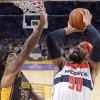Photo - Washington Wizards forward Drew Gooden puts up a shot as Los Angeles Lakers forward Jordan Hill defends during the first half of an NBA basketball game, Friday, March 21, 2014, in Los Angeles. (AP Photo/Mark J. Terrill)