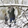 Bob Quakenbush and his daughter Dana Letual clear a fallen tree from his driveway so he can go to work, Thursday, Nov. 8, 2012, in Millstone Township, N.J. The New York-New Jersey region woke up to a layer of wet snow and more power outages after a new storm pushed back efforts to recover from Superstorm Sandy.(AP Photo/Mel Evans)