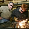 Kenny Leatherwood supervises Edmond High School junior Sam Stokes as he uses a plasma cutter at Edmond Schools Vocational-Agriculture complex in Edmond, Oklahoma March 10, 2009. Sam is deaf and uses a sign language interpreter in his class. BY STEVE GOOCH, THE OKLAHOMAN