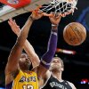 Los Angeles Lakers\' Dwight Howard (12) dunks against Brooklyn Nets\' Brook Lopez (11) in the first half of an NBA basketball game in Los Angeles, Tuesday, Nov. 20, 2012. (AP Photo/Jae C. Hong)