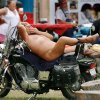 Photo -  A man reclines on his motorcycle while waiting to participate in bike games at the Sparks America Bikers Week in Lincoln County June 19, 2009 . He is not identified, but people at the rally called him Nature Man.  Photo by Jim Beckel, The Oklahoman