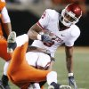 Jacob Lacey of OSU brings down Sooner Juaquin Iglesias during the first half of the college football game between the University of Oklahoma Sooners (OU) and Oklahoma State University Cowboys (OSU) at Boone Pickens Stadium on Saturday, Nov. 29, 2008, in Stillwater, Okla. STAFF PHOTO BY BRYAN TERRY