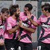 Juventus\' Andrea Pirlo, second from left, celebrates with teammates after scoring during a Serie A soccer match between Juventus and Siena, in Siena, Italy, Sunday, Oct. 7, 2012. (AP Photo/Paolo Lazzeroni)
