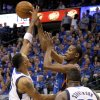 Oklahoma City\'s Kevin Durant (35) passes the ball from between Shawn Marion (0) of Dallas and DeShawn Stevenson (92) during game 5 of the Western Conference Finals in the NBA basketball playoffs between the Dallas Mavericks and the Oklahoma City Thunder at American Airlines Center in Dallas, Wednesday, May 25, 2011. Photo by Bryan Terry, The Oklahoman