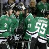 Photo - Dallas Stars' Tyler Seguin (91), Aaron Rome (27) and Sergei Gonchar (55) congratulate Jamie Benn (14) on his goal in the first period of an NHL hockey game against the Toronto Maple Leafs, Thursday, Jan. 23, 2014, in Dallas. (AP Photo/Tony Gutierrez)