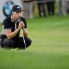 Photo - Germany's  Martin Kaymer  concentrates  during  the  BMW International Open golf tournament  in Pulheim near Cologne, Germany,  Friday June 27, 2014.  (AP Photo/dpa,Rolf Vennenbernd)