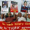 """Communist Party of Bangladesh activists march to protest the visit of U.S. Secretary of State Hillary Clinton in Dhaka, Bangladesh, Friday, May 4, 2012. Hillary arrives Saturday for an official visit to the country. Placards read """"Crush U.S. imperialism,"""" left, and """"Child killer, anti-humanitarian. We condemn U.S. imperialism,"""" second left. (AP Photo/Pavel Rahman)"""