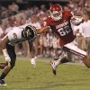 Oklahoma\'s Tanner Gillette (82) stiff arms Missouri\'s Matt White (17) during the college football game between the University of Oklahoma Sooners (OU) and the University of Missouri Tigers (MU) at the Gaylord Family-Memorial Stadium on Saturday, Sept. 24, 2011, in Norman, Okla. Photo by Chris Landsberger, The Oklahoman