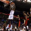 Oklahoma City\'s Hasheem Thabeet (34) dunks the ball beside Toronto\'s Ed Davis (32) during an NBA basketball game between the Oklahoma City Thunder and the Toronto Raptors at Chesapeake Energy Arena in Oklahoma City, Tuesday, Nov. 6, 2012. Tuesday, Nov. 6, 2012. Oklahoma City won 108-88. Photo by Bryan Terry, The Oklahoman