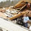 Jennie Hood stands near her belongings after a tornado hit and completely tore down the home she shares with her husband, on Short Tail Springs Rd. Friday, March 2, 2012 in Harrison, Tenn. Powerful storms stretching from the Gulf Coast to the Great Lakes flattened buildings in several states, wrecked two Indiana towns and bred anxiety across a wide swath of the country in the second powerful tornado outbreak this week. (AP Photo/Chattanooga Times Free Press, Ashlee Culverhouse) ORG XMIT: TNCHA118