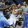 Minnesota Timberwolves\' Nikola Pekovic, center, of Montenegro, tries to hang onto the ball as he tussles with Denver Nuggets\' Kosta Koufos, right, and Kenneth Faried, left, in the first half of an NBA basketball game on Wednesday, Nov. 21, 2012, in St. Paul. (AP Photo/Jim Mone)