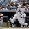 Photo - New York Yankees' Mark Teixeira hits a two-run single during the first inning of the first baseball game of a double-header against the Pittsburgh Pirates at Yankee Stadium, Sunday, May 18, 2014 in New York. (AP Photo/Seth Wenig)