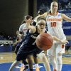 Photo - Chattanooga's Alicia Payne (1) and Syracuse's Isabella Slim (10) chase a loose ball during the first half of a first-round game in the NCAA women's college basketball tournament in Lexington, Ky., Saturday, March 22, 2014. (AP Photo/James Crisp)