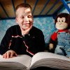 BLIND / BLINDNESS: Daniel Brookshire, a Tulsa eighth-grader, sits on his bed with one of the Braille volumes of the Bible in his family\'s home on Thursday, Jan. 7, 2010. Photo by Jim Beckel, The Oklahoman ORG XMIT: KOD