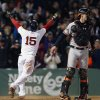 Photo - Boston Red Sox's Dustin Pedroia (15) reacts behind Baltimore Orioles' Matt Wieters after scoring on a throwing error by  David Lough in the ninth inning of a baseball game in Boston, Sunday, April 20, 2014. The Red Sox won 6-5. (AP Photo/Michael Dwyer)