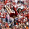 An OU cheerleader flies through the air during the first half of the Bedlam college football game between the University of Oklahoma Sooners (OU) and the Oklahoma State University Cowboys (OSU) at the Gaylord Family-Oklahoma Memorial Stadium on Saturday, Nov. 28, 2009, in Norman, Okla. Photo by Bryan Terry, The Oklahoman
