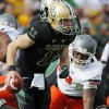 Baylor\'s Nick Florence (11) scrambles away from Oklahoma State\'s Nigel Nicholas (89) during a college football game between the Oklahoma State University Cowboys (OSU) and the Baylor University Bears at Floyd Casey Stadium in Waco, Texas, Saturday, Dec. 1, 2012. Photo by Nate Billings, The Oklahoman